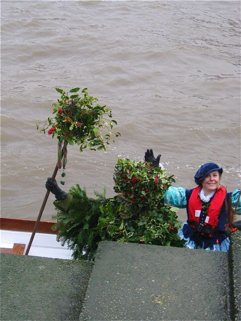 holly man arrives by boat
